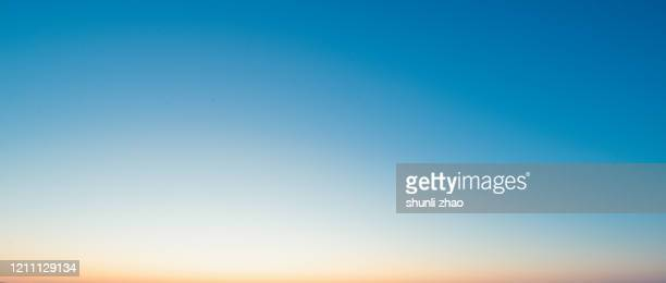 the gradual color of the sky at sunset - blue stock pictures, royalty-free photos & images