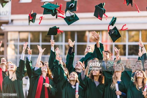 the graduation day is finally here! - graduation crowd stock pictures, royalty-free photos & images