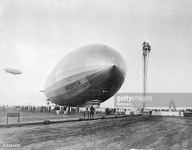 The Graf Zeppelin approaching the mooring mast at Mines Field here after completing its trip from Tokyo in 68 hours for the third successful lap of...