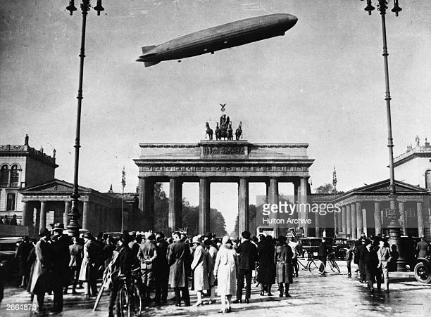 The 'Graf Zeppelin' the world's most successful airship flies over the Brandenburg Gate Berlin
