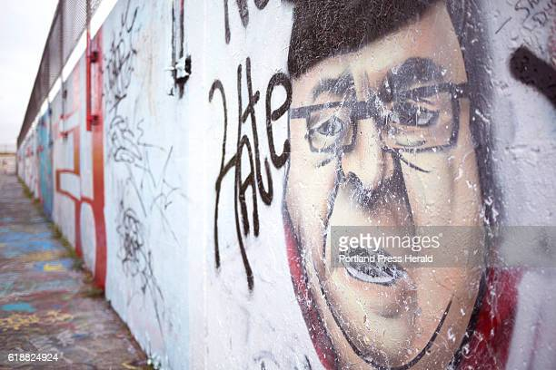 The graffiti of Gov LePage wearing a Ku Klux Klan robe on the Eastern Promenade was painted over by another artist with Mickey Mouse ears and the...