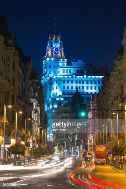 the gran via and edificio telefónica at night in central madrid. - gran via madrid fotografías e imágenes de stock