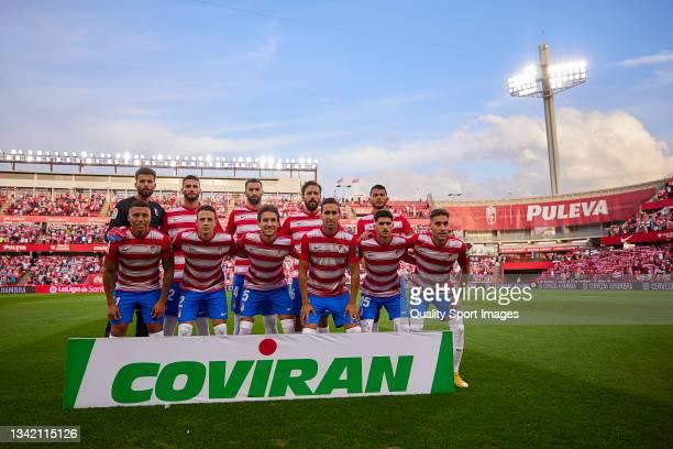 The Granada CF team line up for a photo prior to kick off the La Liga Santander match between Granada CF and Real Sociedad at Nuevo Estadio de Los...