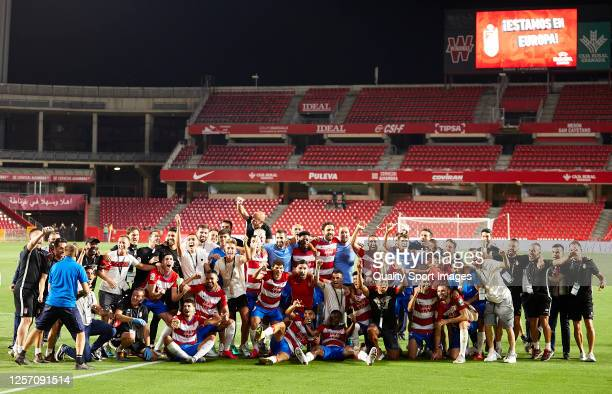 The Granada team celebrate qualifying for the qualifying rounds of the Europa League after the Liga match between Granada CF and Athletic Club at...
