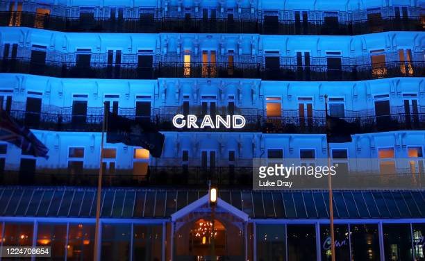 The Grand Brighton hotel is lit up with blue lights as part of the 'Light It Blue' campaign for the NHS anniversary on July 4, 2020 in Brighton,...