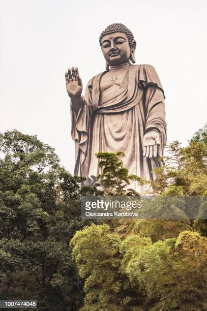 The Grand Buddha at Ling Shan, a bronze Amitabha sculpture standing more than 88 metres high.