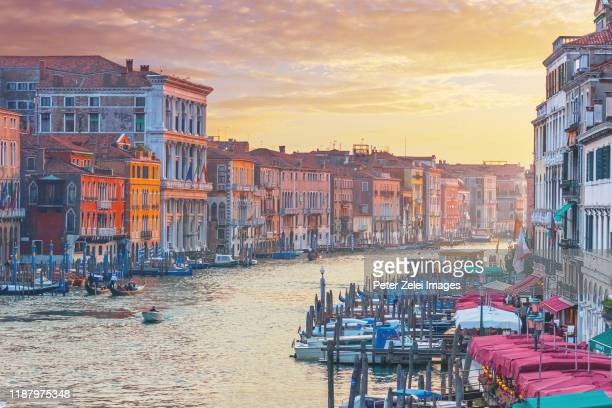 the grand canal in venice at sunset - venice stock pictures, royalty-free photos & images