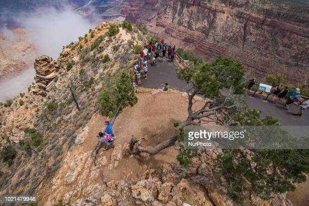 The Grand Canyon and Mary Colter's designed Watchtower are seen from the South Rim in Grand Canyon Village Arizona United States at the Desert View...