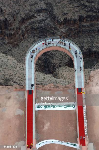 The Grand Canyon Skywalk in Arizona Indian leaders and former astronauts step gingerly beyond the Grand Canyon's rim staring through the glass floor...