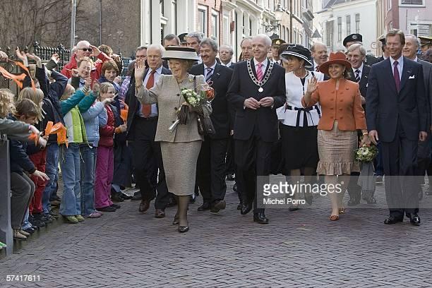 The Grand Duke Henri of Luxemburg and his wife Maria Teresa walk with Dutch Queen Beatrix April 25 2006 in Leeuwarden the Netherlands Grand Duke...