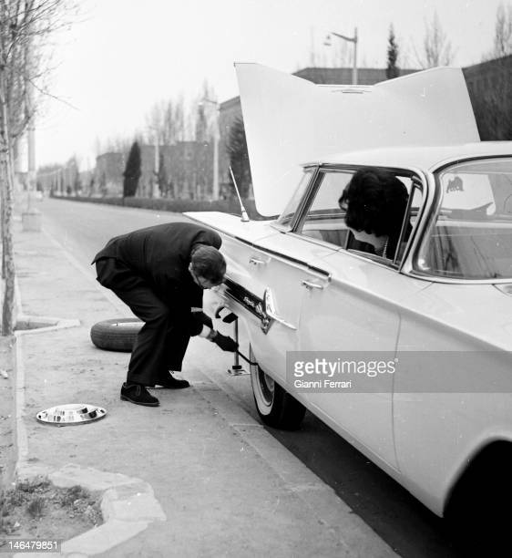 The Grand Duke Vladimir Kirillovich Romanov, head of the Russian imperial dynasty, change himself a wheel of his car Madrid, Spain. .