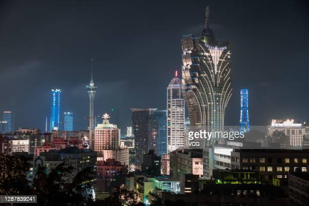 The Grand Lisboa Hotel is illuminated at night on November 20, 2020 in Macao, China.