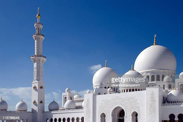 the grand mosque in abu dhabi with beautiful blue sky - mosque stock pictures, royalty-free photos & images