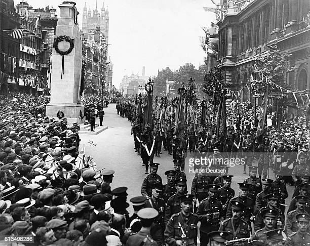 The grand Peace Day parade to mark the end of World War I passes the Cenotaph war memorial in Whitehall London