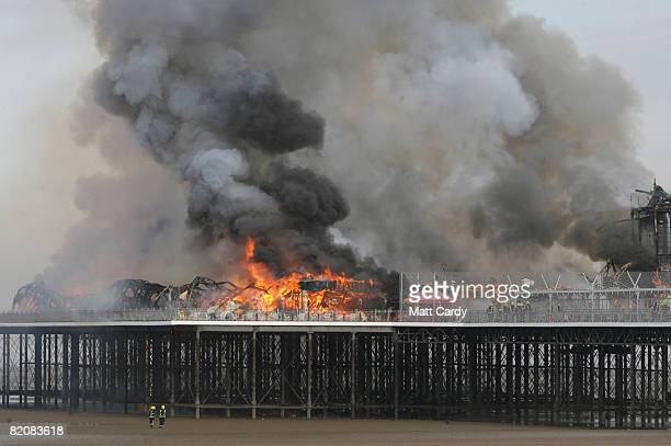 The Grand Pier burns at WestonSuperMare on July 28 2008 in WestonSuperMare England Firefighters are tackling the huge fire that has engulfed the...