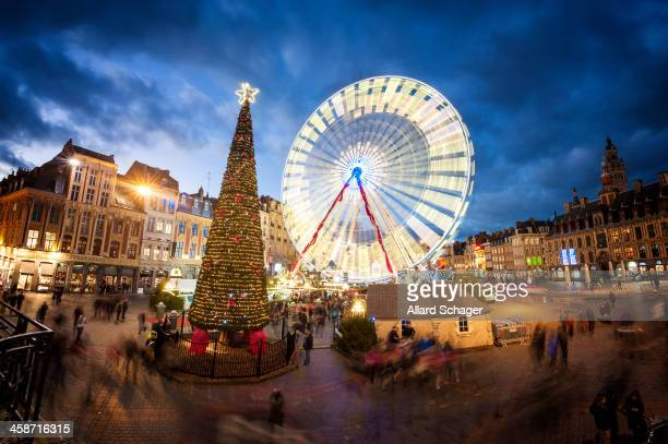 The Grand Place in Lille, France, where in december a giant christmas tree and Ferris Wheel are erected. Long exposure.