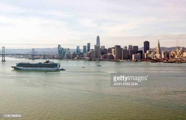The Grand Princess cruise ship passes by San Francisco California on March 09 2020 More than 3000 passengers are stuck at sea after at least 21...