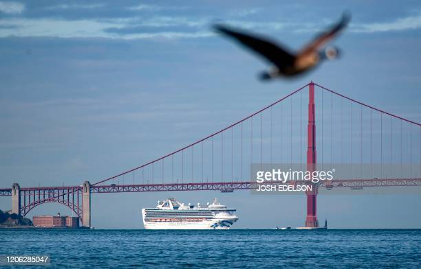 The Grand Princess cruise ship passes under the Golden Gate Bridge as it heads in to shore in San Francisco California on March 09 2020 More than...