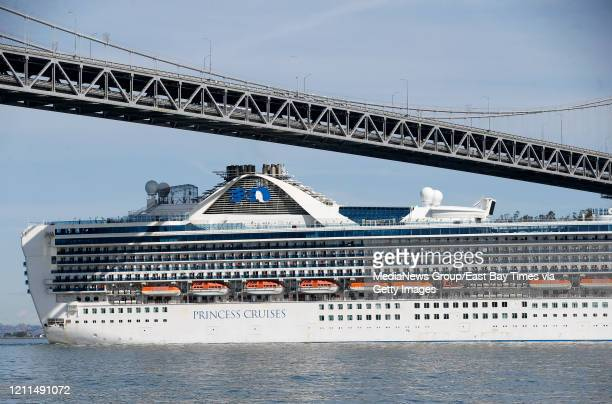 The Grand Princess cruise ship passes underneath the western span of the Bay Bridge as it heads to the Port of Oaklandu2019s Outer Harbor in Oakland...