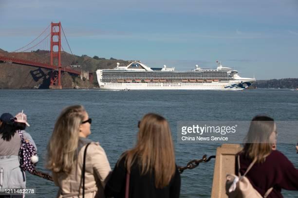 The Grand Princess cruise ship sails through Golden Gate Bridge on March 9, 2020 in San Francisco, USA. The Grand Princess cruise ship docked at Port...