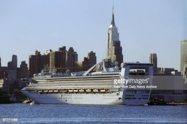 The Grand Princess the world's largest and most expensive cruise ship makes it's New York City debut as it heads into Pier 88 at 55th St and 12th Ave...