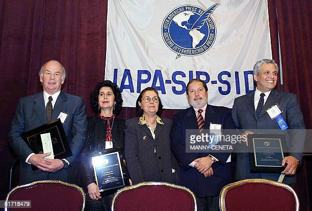 The Grand Prize for Press Freedom is awarded by the Inter American Press Association President of Busqueda Danilo Arbilla of Montevideo Uruguay to...