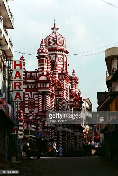 The grand red and white JamiUlAlfar Mosque in the middle of Pettah District of Colombo caters to the country's minority Muslim population