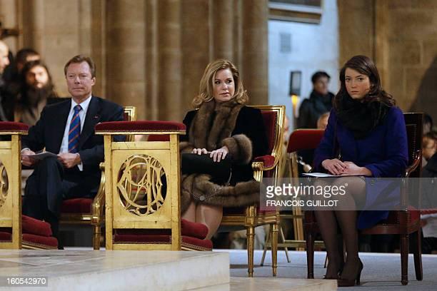 The GrandDuke Henri of Luxembourg his wife GrandDuchess Maria Teresa and their daughter Princess Alexandra attend a mass at Paris' NotreDame de Paris...