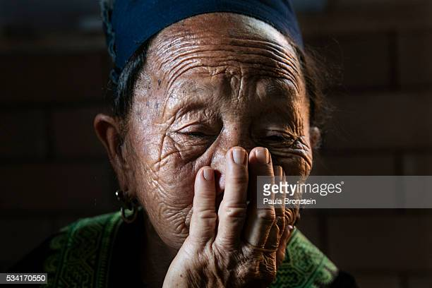 The grandmother of Kanjanaporn Lasasong age 8 grieves at her funeral in Mae Wang Chiang Mai province May 25 2016 A tragic fire broke out on Sunday...