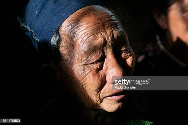 The grandmother of Kanjanaporn Lasasong age 8 grieves at her funeral in Mae Wang Chiang Mai province May 24 2016 A tragic fire broke out on Sunday...