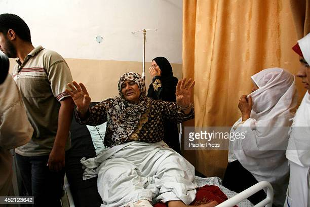 The grandmother of three-year-old Palestinian child, Mouid al-Araj, mourns during his funeral in Khan Yunis, in the southern Gaza Strip. Israeli...