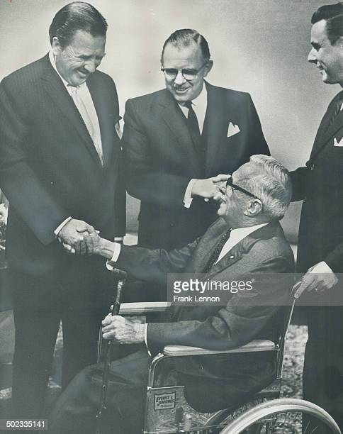 The grandson of Ford's founder; Henry Ford II; head of the parent Ford firm; greets A. M. Cruickshank; of Weston; one of the oldest Ford dealers in...