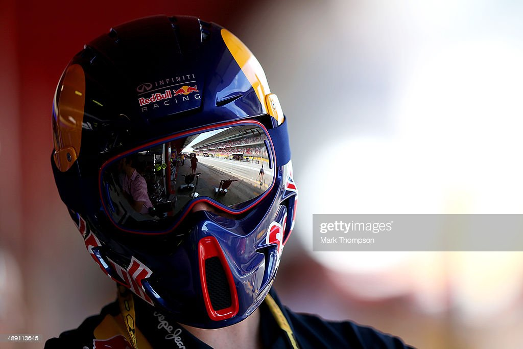 The grandstand and pit lane are reflected in the goggles of a member of the Infiniti Red Bull Racing team during qualifying ahead of the Spanish F1 Grand Prix at Circuit de Catalunya on May 10, 2014 in Montmelo, Spain.