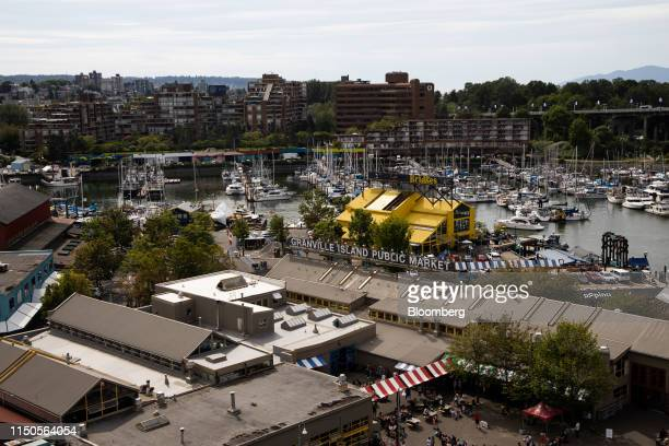 The Granville Island Public Market stands in Vancouver British Columbia Canada on Sunday June 2 2019 Statistics Canada is scheduled to release...
