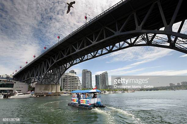 The Granville St bridge and the Aquabus a small boat shuttle which transports Vancouverites and tourists across False Creek to destinations which...