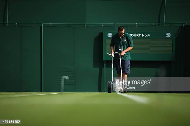 The grass courts are prepared prior to the matches on day two of the Wimbledon Lawn Tennis Championships at the All England Lawn Tennis and Croquet...