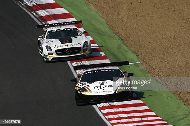 The Grasser Racing Team Lamborghini FLII driven by Jeroen Bleekemolen of the Netherlands and Hari Proczyk of Austria lead the HTP Motorsport Mercedes...