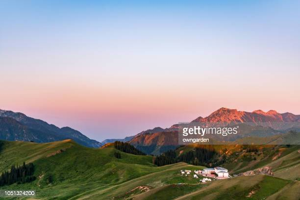 the grassland scenery at sunrise,xinjiang province,china - tien shan mountains stock pictures, royalty-free photos & images