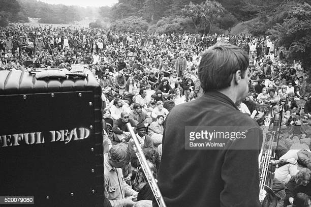 The Grateful Dead playing in front of the audience at the Human Be In Festival Golden Gate Park San Francisco CA on January 14 1967