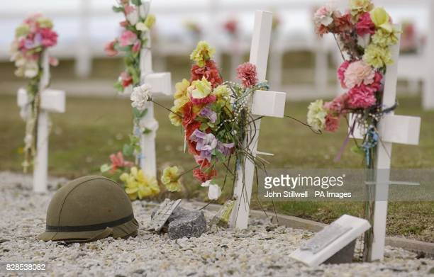 The grave of Argentine solider Eusebio Antonio Aguilar with his helmet at the Argentinian Cemetery on East Falkland Island which the Duke of York...
