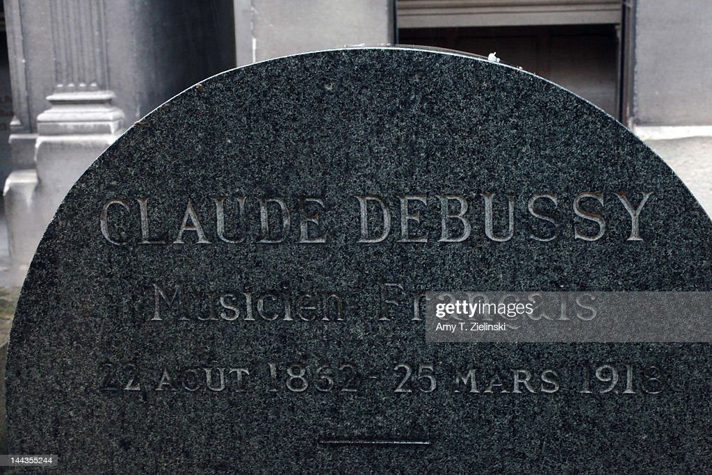 The grave of French composer Claude Debussy (1862 - 1918) at Passy Cemetery in Paris, 25th April 2012. Debussy's wife Emma Bardac and daughter Claude-Emma are buried with him.