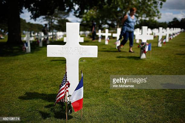 The grave of Private First Class Ray Cupp is shown on the eve of the 70th anniversary of DDay at the Normandy American Cemetery June 5 2014 in...
