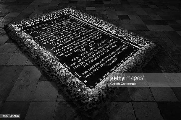 The grave of the Unknown Warrior surrounded by poppies inside Westminster Abbey on November 17 2015 in London England Westminster Abbey houses over...