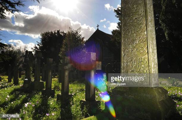 The grave of Victorian critic author and artist John Ruskin at St Andrew Churchyard March 18 2011 in Coniston England