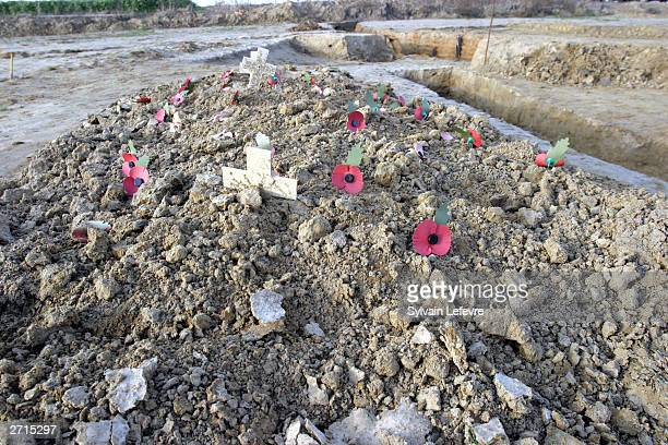The grave which contains the remains of an identified soldier of the Fifth Battalion Northumberland Fusiliers are seen on November 10 2003 in Ypres...