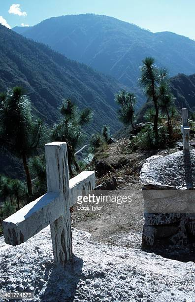 The graves of Catholic worshippers overlook the Mekong River valley above Cizhong in Northern Yunnan Bought to the area by French missionaries in the...