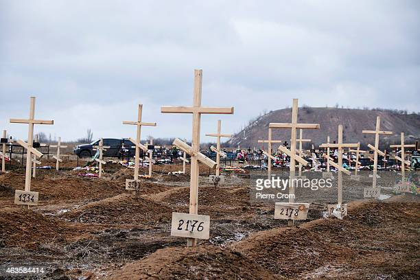 The graves of fighters without names marked with numbers in the cemetery of Mospyne on February 16 2015 in Mospyne Ukraine Four rebel fighters died...