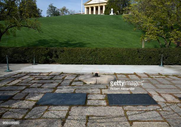 The graves of former US President John F Kennedy and his wife Jacqueline Kennedy Onassis at Arlington National Cemetery near Washington DC