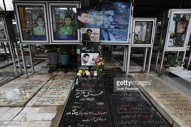 The graves of two Iranian 'martyrs' killed while 'defending Zeinab's Shrine' in Damascus Syria are laid among the dead martyrs of the 1980s IranIraq...