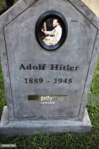 The gravestone of Adolf Hitler from the art installation Eternity is displayed after the ceremony where Italian artist Maurizio Cattelan is given...